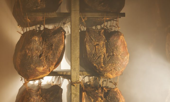 The gentle smoking process for Speck Alto Adige consists of five hours of smoke followed by five hours of fresh mountain air, over the course of a week. (Frieder Blickle)