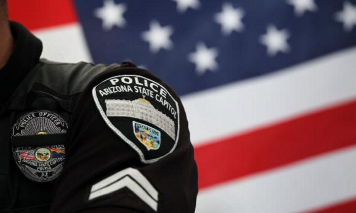 A policeman stands guard in Phoenix Ariz., on July 31, 2010. (John Moore/Getty Images)