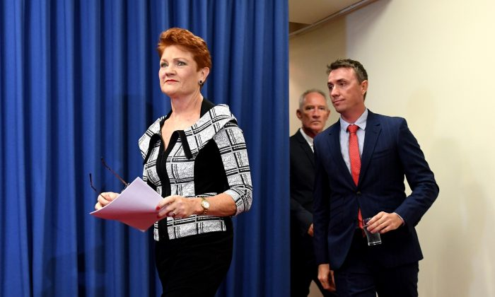 One Nation Leader Pauline Hanson (L) arrives at a press conference together with James Ashby (far R) and Steve Dickson (centre R) in Brisbane, Australia, on March 28, 2019. (Bradley Kanaris/Getty Images)