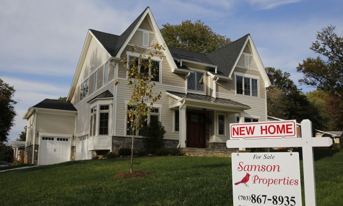A real estate sign advertising a new home for sale is pictured in Vienna, Va., on Oct. 20, 2014. (Larry Downing/Reuters)
