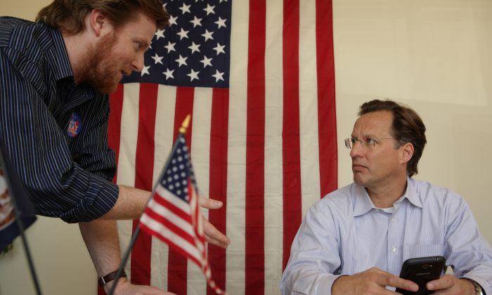 College economics professor and Republican candidate for Congress David Brat (R) talks to campaign manager Zach Werrell April 26, 2014 in Glen Allen, Virginia.  Jay Paul/Getty Images