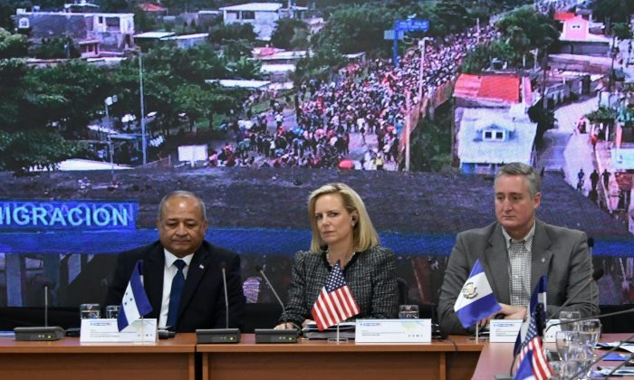 U.S. Secretary of Homeland Security Kirstjen Nielsen (2nd L), Honduran Security Minister Julian Pacheco (L) and Guatemalan Minister of Government Enrique Degenhart attend the V Meeting of Ministers and Secretaries of Security of the Northern Trialgle and the US in Tegucigalpa on March 27, 2019. (Orlando Sierra/AFP/Getty Images)