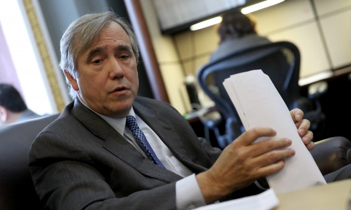Sen. Jeff Merkley (D-Ore.) speaks with reporters in a file photo. (Win McNamee/Getty Images)