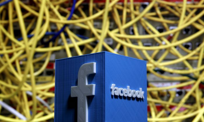 A 3D plastic representation of the Facebook logo is seen in front of displayed cables in this illustration in Zenica, Bosnia and Herzegovina, on May 13, 2015. (Dado Ruvic/File Photo via Reuters)