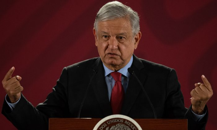 Mexican President Andres Manuel Lopez Obrador gestures during his daily morning press conference at the National Palace in Mexico City on March 26, 2019. (Pedro Pardo/AFP/Getty Images)