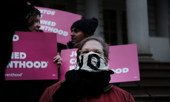 Pro-choice activists, politicians and others associated with Planned Parenthood gather for a news conference and demonstration at City Hall against the Trump administrations title X rule change on February 25, 2019 in New York City.  Spencer Platt/Getty Images