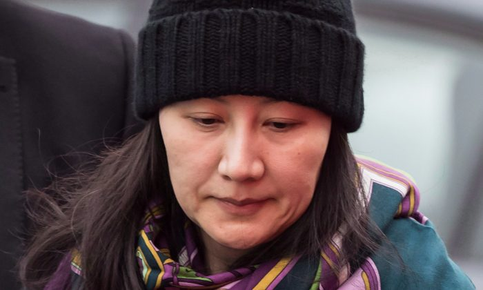 Huawei chief financial officer Meng Wanzhou arrives at a parole office, in Vancouver on Dec. 12, 2018. On April 3, The U.S. Senate Foreign Relations Committee is set to discuss a resolution commending the Canadian government for upholding the rule of law in Meng's arrest. (The Canadian Press/Darryl Dyck)