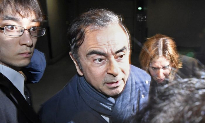 Former Nissan Motor Chairman Carlos Ghosn leaves his lawyer's office in Tokyo, Japan in this photo taken by Kyodo April 3, 2019. Picture taken on April 3, 2019. Mandatory credit Kyodo/via REUTERS