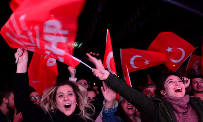 Supporters of the main opposition Republican People's Party (CHP) cheer in front of the party's headquarters as they celebrate the municipal elections results in Ankara, Turkey, March 31, 2019. REUTERS/Stringer
