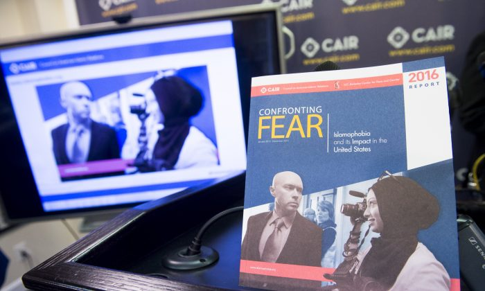 "A report titled ""Confronting Fear,"" about Islamophobia in the United States released by the Council on American-Islamic Relations (CAIR), is seen at their headquarters in Washington, DC, June 20, 2016. (SAUL LOEB/AFP/Getty Images)"
