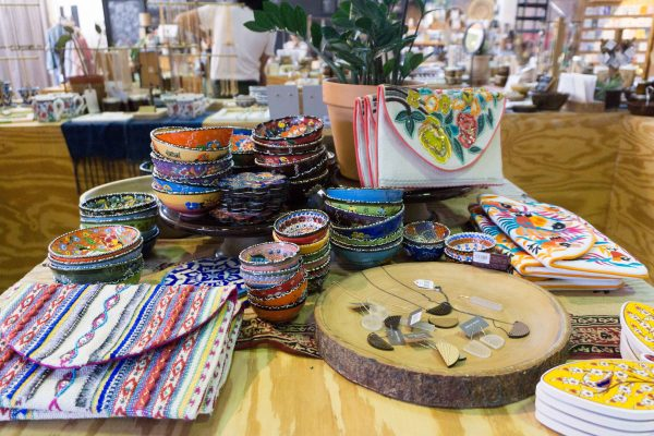 Colorful dishware and purses at Seed Peoples Market