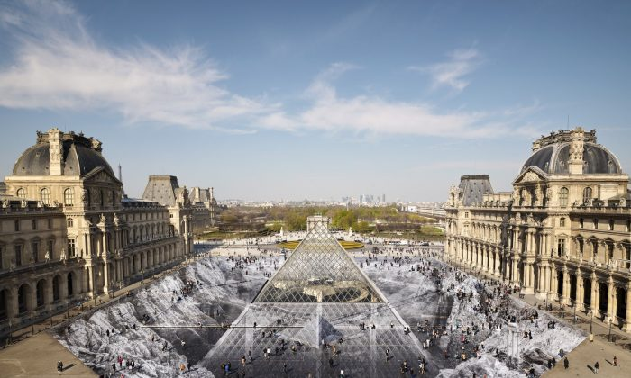French Street Artist JR used 2,000 pieces of paper to create the Secret of the Great Pyramid, an optical illusion of the Louvre pyramid emerging from a rock quarry, on March 30, 2019. (Courtesy of JR/Twitter)