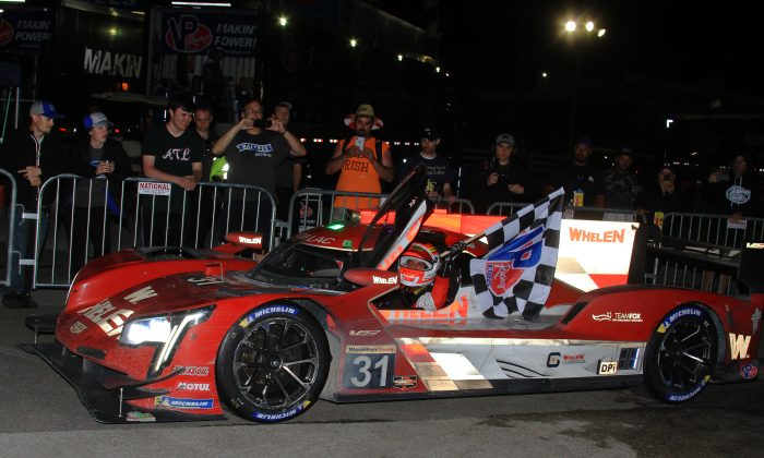 Felipe Nasr wheels the race-winning #31 Whelen Cadillac into Victory Lane at the end of the 2019 IMSA Sebring 12 Hours, March 16. 2019. (Chris Jasurek/Epoch Times)
