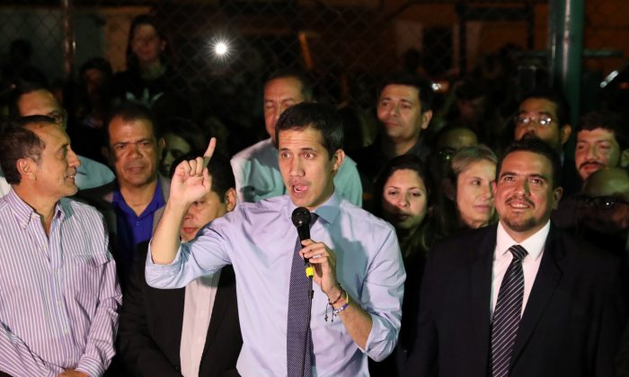 FILE PHOTO - Venezuelan opposition leader Juan Guaido, who many nations have recognized as the country's rightful interim ruler, talks to the media during a news conference in Caracas, Venezuela April 2, 2019. REUTERS/Manaure Quintero