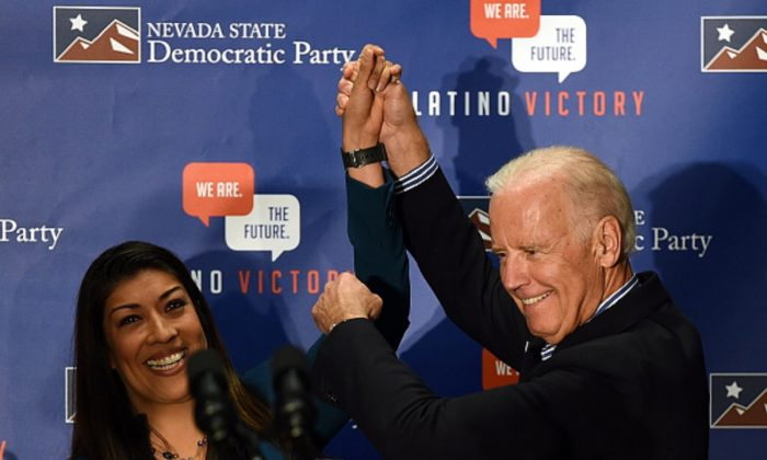 Democratic candidate for lieutenant governor and current Nevada Assemblywoman Lucy Flores (D-Las Vegas) (L) introduces U.S. Vice President Joe Biden at a get-out-the-vote rally at a union hall in Las Vegas, Nevada, on Nov. 1, 2014. (Ethan Miller/Getty Images)