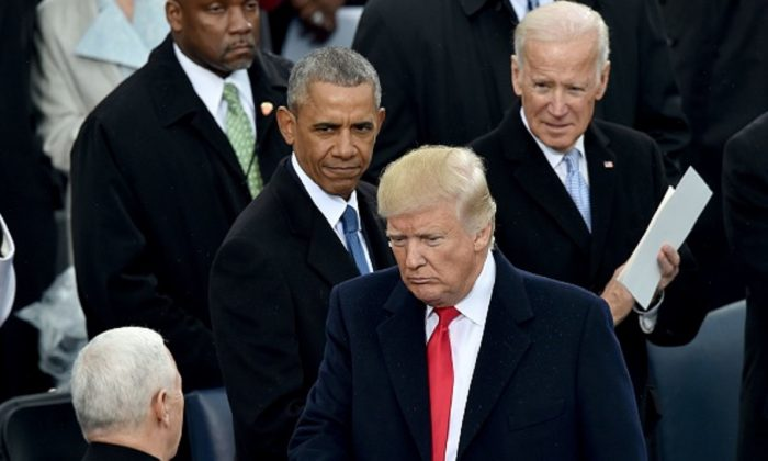 President Donald Trump(2nd-R) with Vice President Mike Pence(L) as former President Barack Obama and former Vice President Joe Biden(R) look on Trump's inauguration ceremonies at the US Capitol in Washington, on Jan. 20, 2017. (Paul J. Richards/AFP/Getty Images)
