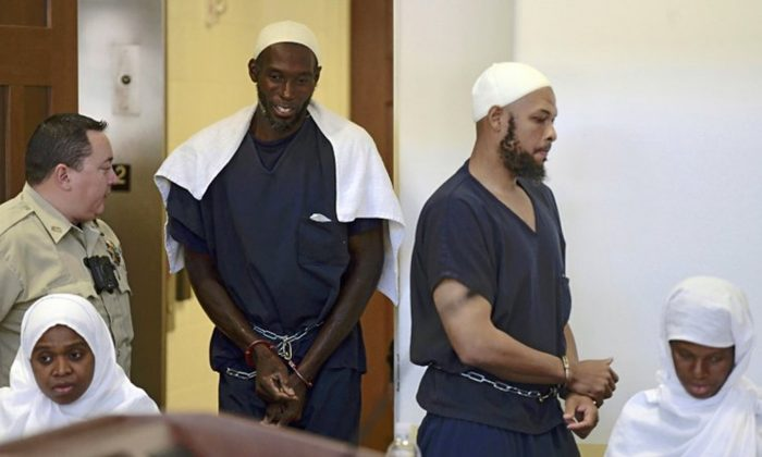 This Aug. 13, 2018 pool file photo shows defendants, from left, Jany Leveille, Lucas Morton, Siraj Ibn Wahhaj and Subbannah Wahhaj entering district court in Taos, N.M. U.S. prosecutors will not seek the death penalty against the four adults who lived at a New Mexico compound where authorities found the remains of a toddler who was reported missing in Georgia, court documents say. (Roberto E. Rosales/The Albuquerque Journal via AP, Pool, File)