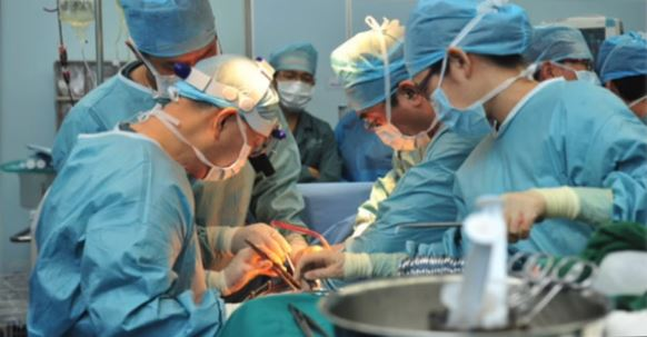 "Doctors performing an organ transplant in China as seen in the film ""Harvested Alive: 10 Years of Investigations."" (Screenshot/""Harvested Alive: 10 Years of Investigations"")"