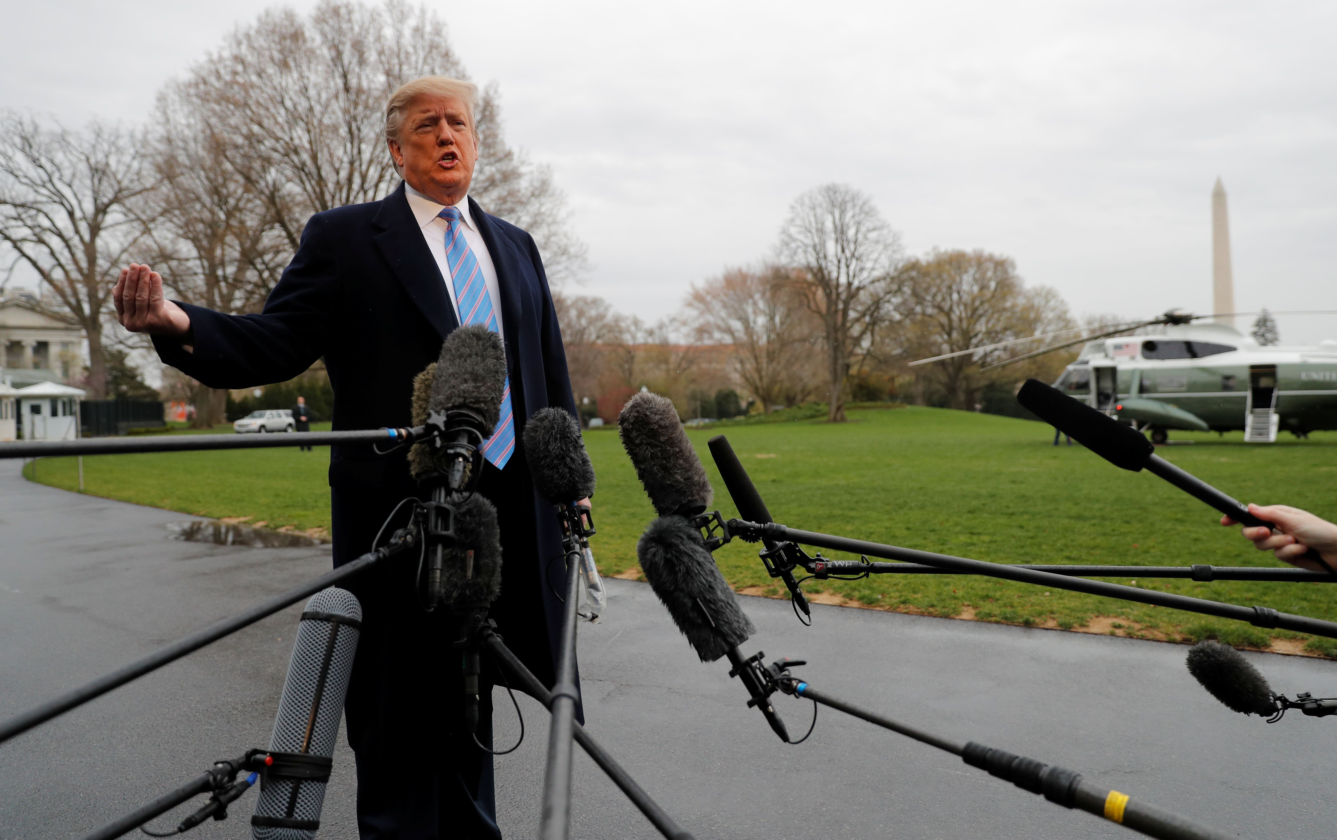 President Donald Trump talks to reporters as he departs for travel to the U.S.-Mexico border from the White House