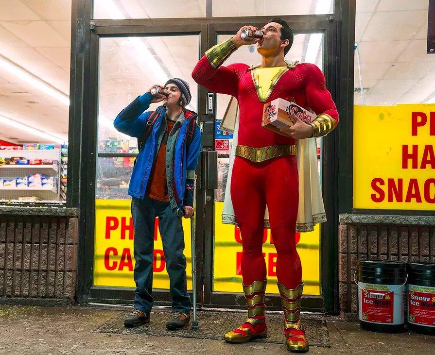 superhero in red suit, boy in blue coat