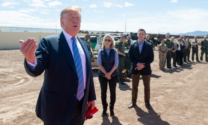 President Donald Trump speaks with members of the U.S. Customs and Border Patrol as he tours the border wall between the United States and Mexico in Calexico, Calif., on April 5, 2019. (Saul Loeb/AFP/Getty Images)