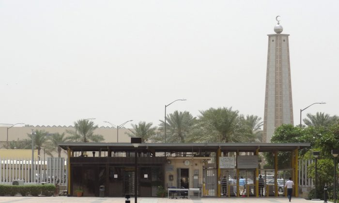 "A mosque is seen behind the entrance gate to the administration area of Saudi Aramco headquarters, on May 10, 2016 in Dhahran, 400kms east of the capital Riyadh. Despite collapsed global oil prices, production is expanding at Shaybah, as it is in other units of the company at the centre of the kingdom's Vision 2030 drive for diversification away from oil. The Saudi government plans to sell less than five percent of the company in what officials say will be the world's largest-ever share offering, while transforming Saudi Aramco into ""a global industrial conglomerate"". By 2020 the company says it will have tripled its gas processing capacity from levels at the turn of the century.  / AFP / IAN TIMBERLAKE        (Photo credit should read IAN TIMBERLAKE/AFP/Getty Images)"