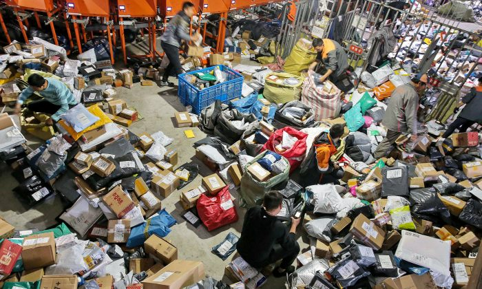 """Workers sort packages after the """"Singles Day"""" online shopping festival at a delivery company in Nantong City, Jiangsu Province, China, on November 15, 2018. (STR/AFP/Getty Images)"""