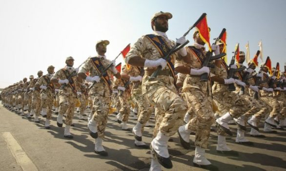 Members of the Iranian revolutionary guard march during a parade to commemorate the anniversary of the Iran-Iraq war, in Tehran