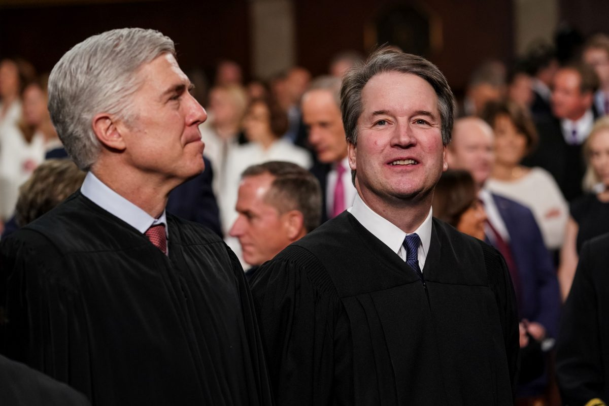 Supreme Court Justices Neil Gorsuch and Brett Kavanaugh attend the State of the Union address in the chamber of the U.S. House of Representatives at the U.S. Capitol Building