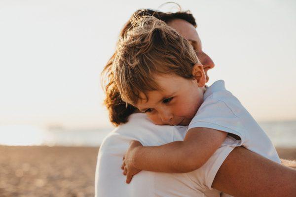 mom hugging son