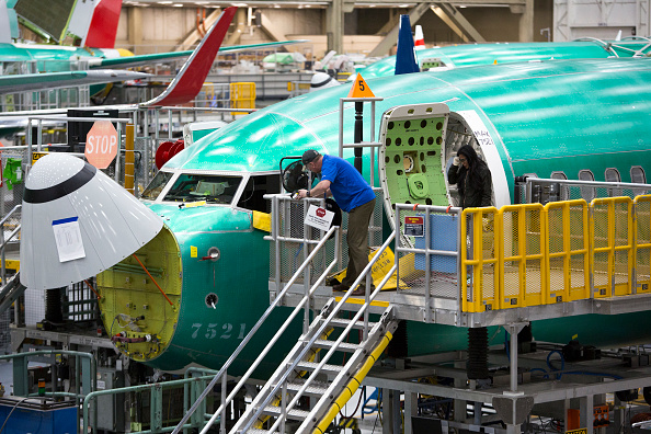 Employees work on Boeing 737 MAX airplanes at the Boeing Renton Factory in Renton, Washington on March 27, 2019. JASON REDMOND/AFP/Getty Images