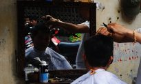 Man Attempts to Forcibly Cut Barber's Hair Over Bad Haircut