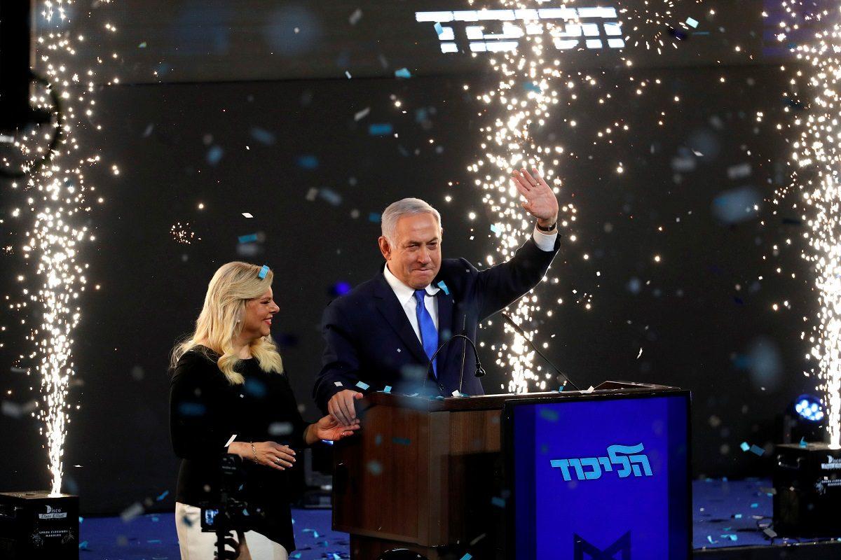 Confetti falls as Israeli Prime Minister Benjamin Netanyahu and his wife