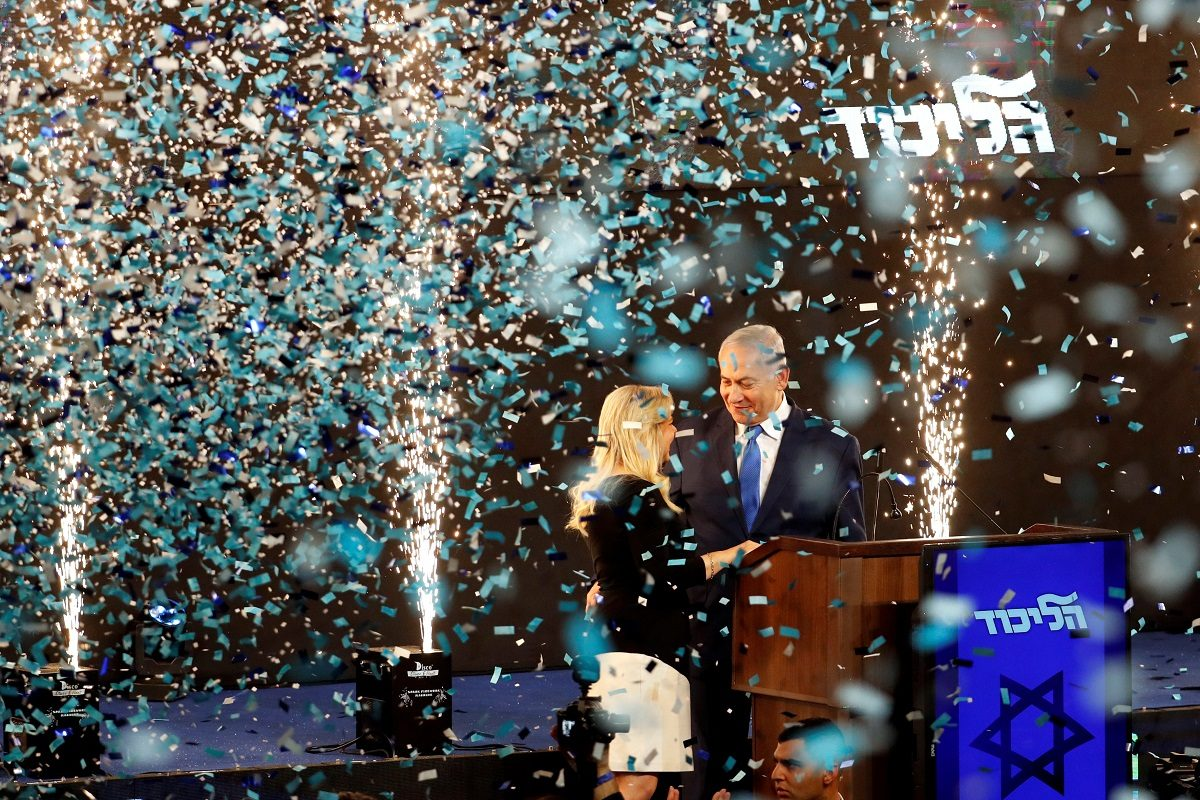 Confetti falls as Israeli Prime Minister Benjamin Netanyahu and his wife Sara