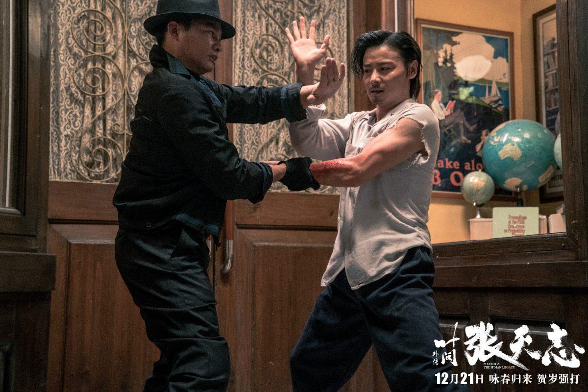 Two men use kung fu blocks