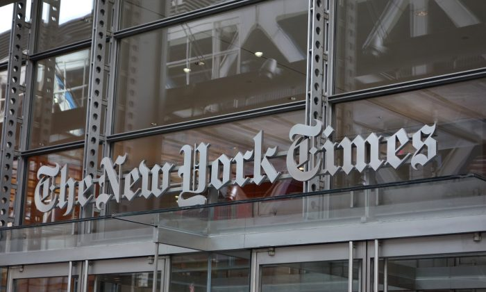 The sign over the west entrance of the New York Times building at 620 8th Ave. in New York on April 28, 2016. (DON EMMERT/AFP/Getty Images)