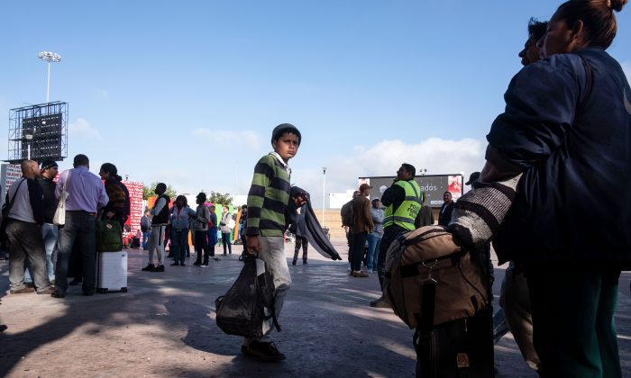 Asylum seekers wait for their turn to request asylum to US authorities outside El Chaparral port of entry in Tijuana, Baja California state, Mexico, on April 9, 2019. (Guillermo Arias/AFP/Getty Images)