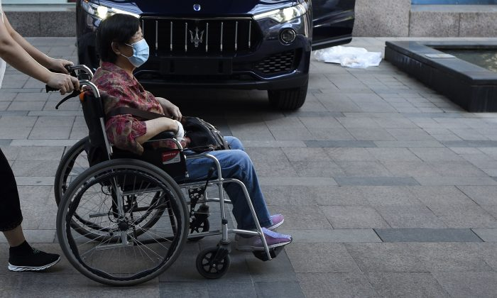A woman pushed in her wheelchair in China. (WANG ZHAO/AFP/Getty Images)