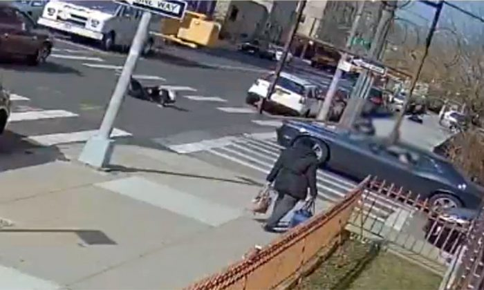 The terrifying moment a black Dodge Challenger muscle car struck a pedestrian in Borough Park, New York, on March 27, 2019. (NYPD Patrol Borough Brooklyn North)