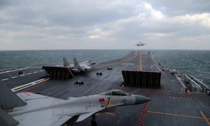 Chinese J-15 fighter jets are launched from the deck of the Liaoning aircraft carrier during military drills in the Yellow Sea, off China's east coast on Dec. 23, 2016. (STR/AFP/Getty Images)