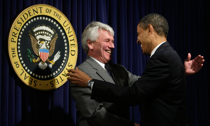 President Barack Obama (R) greets White House counsel Gregory Craig during an event at the Eisenhower Executive Office Building of the White House Jan. 21, 2009. (Alex Wong/Getty Images)