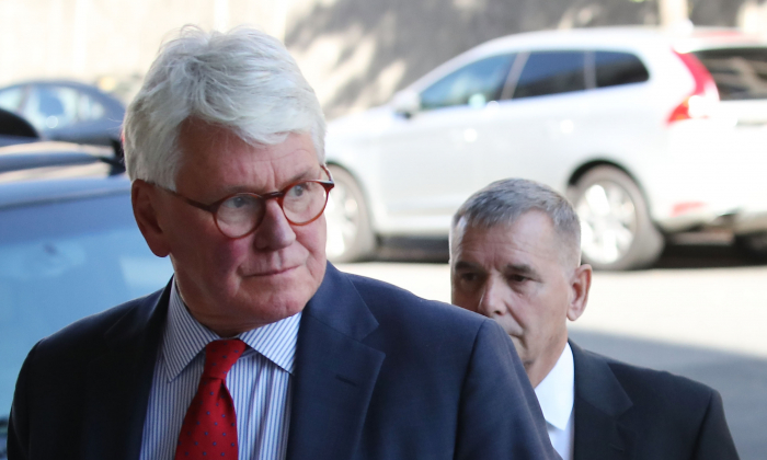 Attorney Greg Craig (L) arrives at US District Court in Washington on Oct. 17, 2016. (Mark Wilson/Getty Images)