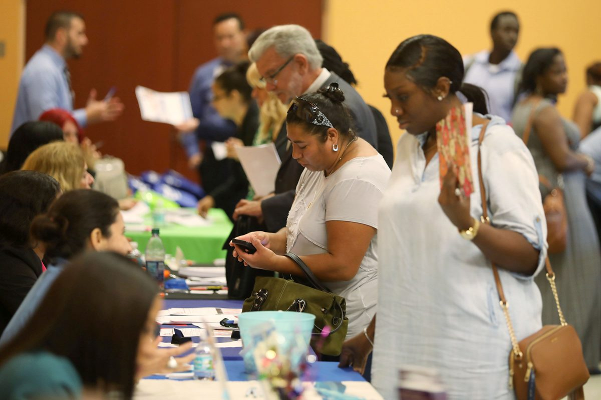 People attend a job fair put on by Miami-Dade County and other sponsors in Miami