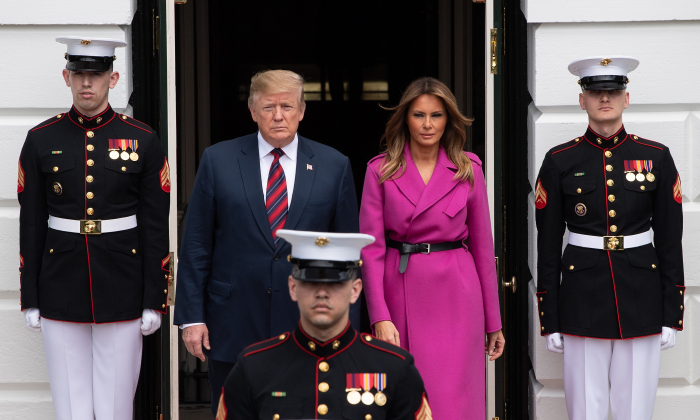 President Donald Trump and first lady Melania Trump walk out of the White House to welcome South Korean President Moon Jae-in and his wife Kim Jung-sook in Washington on April 11, 2019. (Nicholas Kamm/AFP/Getty Images)
