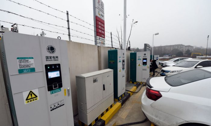 Electric cars charge at a Sinopec service station in Hangzhou, in China's eastern Zhejiang province on Jan. 14, 2019. The service station is one of the first in the country to offer petrol, compressed natural gas (CNG) and electric car charging service. (STR/AFP/Getty Images)