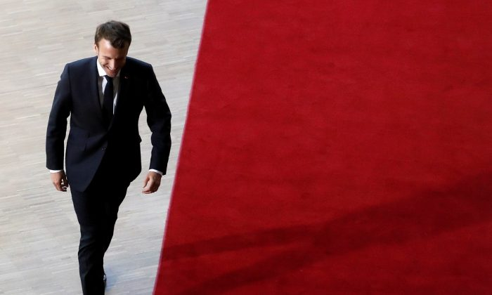 French President Emmanuel Macron arrives at an extraordinary European Union leaders summit to discuss Brexit, in Brussels, Belgium on April 10, 2019.  (Susana Vera/Reuters)