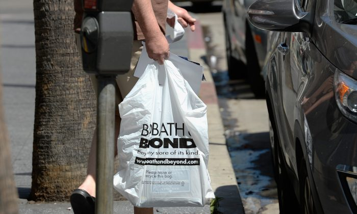 Customers carry bags from a Bed Bath & Beyond store in Los Angeles, Calif. on April 10, 2013. (Kevork Djansezian/Getty Images)