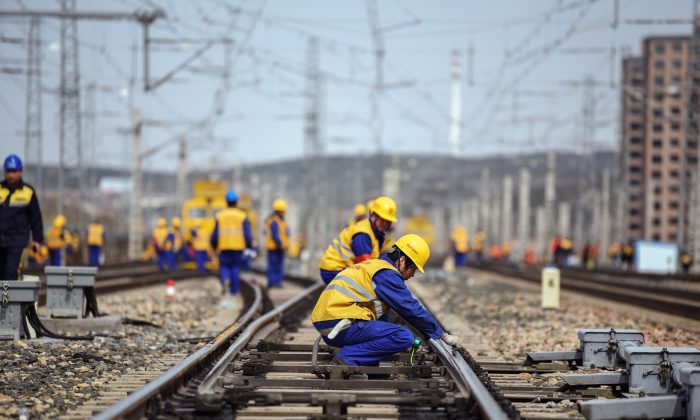 Workers are seen at a construction site of the Tangshan-Hohhot railway in Ulanqab, north China's Inner Mongolia region, March 19, 2019.  China has drastically increased infrastructure spending in 2019. (STR/AFP/Getty Images)