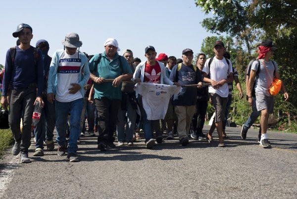 Migrants break border gate 3