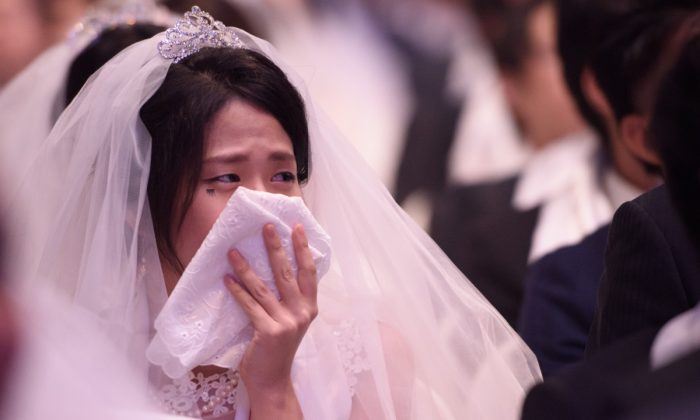 A woman cries at a wedding. (ED JONES/AFP/Getty Images)